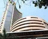 Sensex ends moderately higher in volatile trade