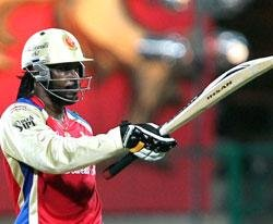 Gayle storm propels RCB to top
