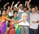 BJP plunges into celebratory mode, urges Guv's recall