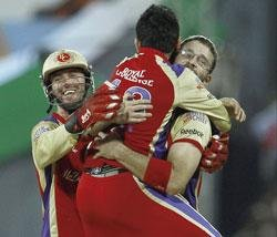 Gayle force opens door to final for Bangalore