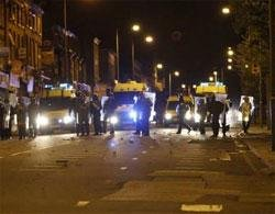 British cities clear up after looting, London quiet