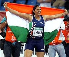 Poonia wins gold, crosses Olympic qualification 'A' standard