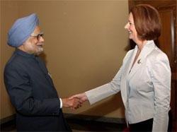 Singh, Gillard meet in Bali; discuss uranium sale issue