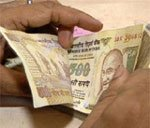 Rupee sinks to record low