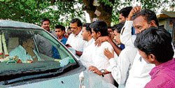 Enraged public block way of district in-charge minister's car