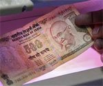 Rupee advances by 33 paise against dollar