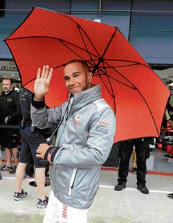 Hamilton sets pace in slippery conditions