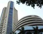Sensex closes 16 points down