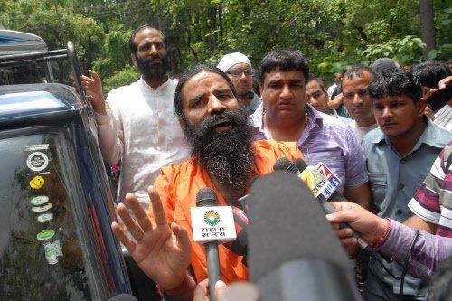Ramdev on dharna against aide's arrest