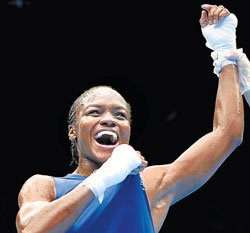 Adams surges to boxing gold