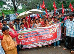 'Cancel contract system, provide minimum wages'