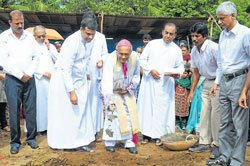Bishop lays foundation for 28 houses