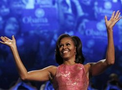 Michelle Obama says change takes time, urges four more years
