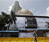 Sensex pares early gains,closes 33 points higher ahead of ECB meet