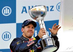 Sizzling Vettel steals show
