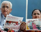 Khurshid shows pictures, documents to prove camps were held