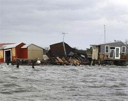 Devastated New York, New Jersey begin slow recovery