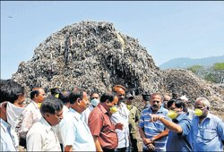 Mound of waste woes greets minister