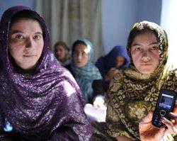 Afghan women learn literacy through mobile phones