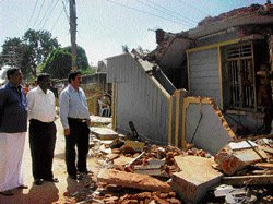 Forensic team visits house blast site