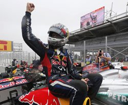 Vettel seals historic treble at dramatic Brazilian GP