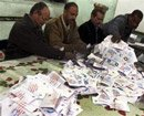 Egypt's constitution approved in vote, say rival camps