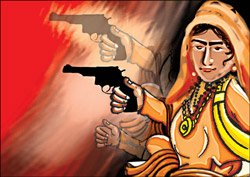 Gun-toting woman monk cynosure at Kumbh