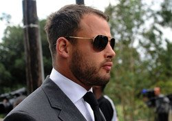 Sobbing Pistorius accused of 'premeditated' girlfriend murder