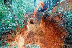 Villagers dig trenches to save crops, lives