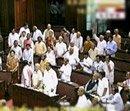 Rajya Sabha witnesses rowdy scenes, chairman's mike broken