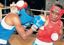 Olympic boxing drops head guards, changes scoring