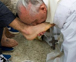 Pope Francis washes women's feet in break with church law