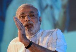 Modi uses FICCI meet to showcase himself