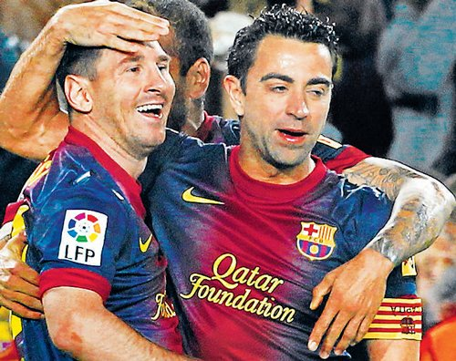 Messi brace helps Barca inch closer  to crown