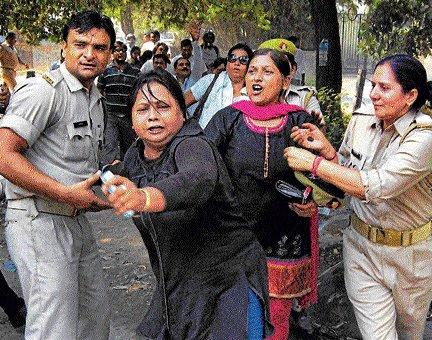 Girl students demand laptops, block road