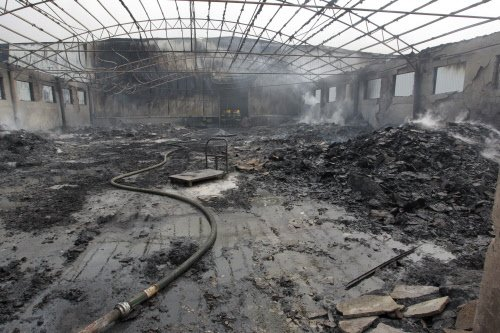 China attributes deadly factory blaze to negligence