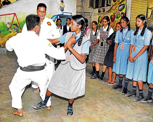 Using karate to deter crimes and build morale
