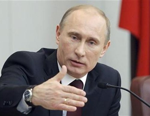 Putin says Snowden at Moscow airport, rejects extradition