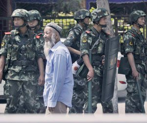China 'terrorists' riot in latest Xinjiang clash: report
