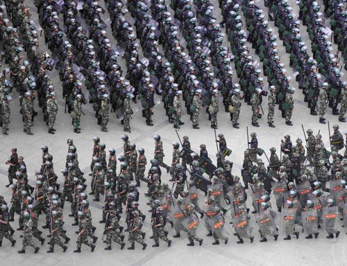 China beefs up security in riot-hit Xinjiang