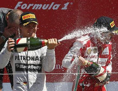 Rosberg triumphs in Britain after Vettel retires