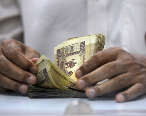 Rupee up 9 paise Vs dollar in late morning deals