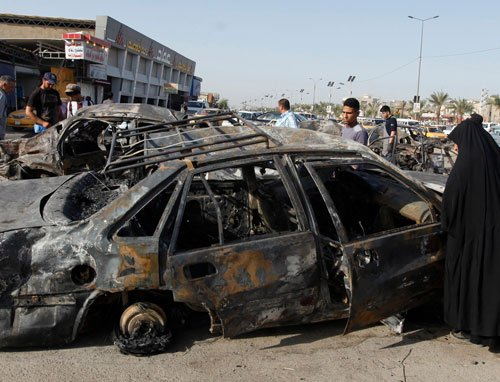 Officials: Bombs, clashes kill at least 60 in Iraq
