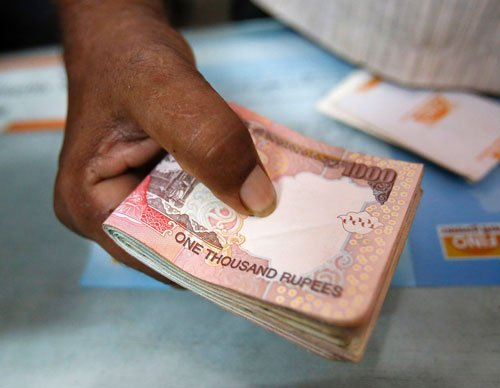 Rupee snaps 3-day fall, gains eight paise to 60.13 vs dollar