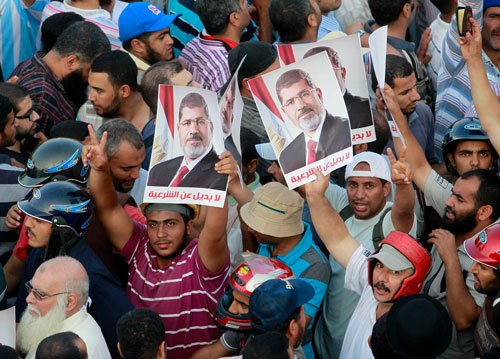 Egypt orders arrest of Brotherhood chief over deadly clashes