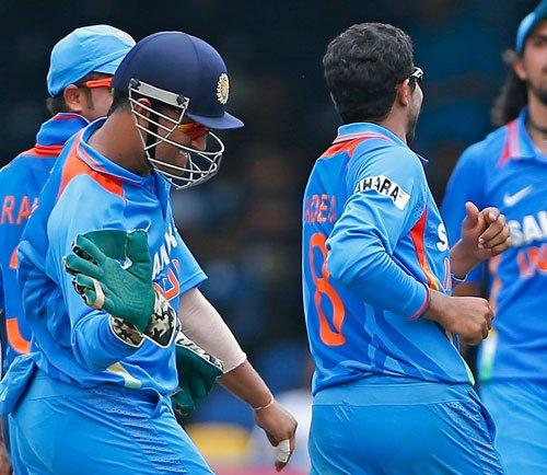 'Captain Cool' Dhoni does it again as India triumph