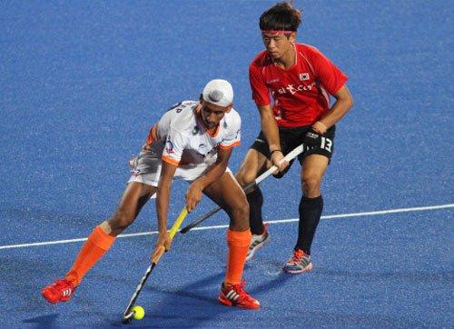 India go down fighting to Korea