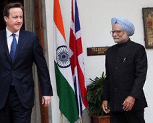 Cameron claims India support on Syria; Delhi raises issue