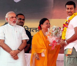 Olympic hero Rathore joins BJP, takes VRS from Army