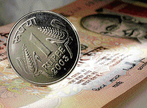 Rupee down 65 paise against dollar in early trade